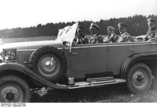 Kempka driving Hitler and Benito Mussolini in September 1937.