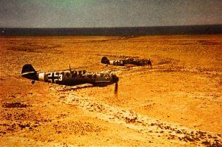 Bf 109Es of JG 27 in flight over North Africa.