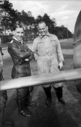 Hauptmann Günther Specht (left) with Dr. Kurt Tank beside the tail of his aircraft in July 1944.