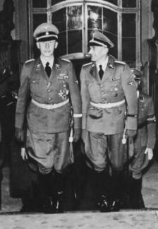 Heydrich (left) with Karl Hermann Frank at Prague Castle in 1941.