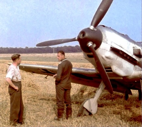 Luftwaffe ace Oberfeldwebel Max Buchholz from 1.Staffel / I.Gruppe / Jagdgeschwader 3 (JG 3) in front of a Messerschmitt Bf 109 E-5 in France, 1940.