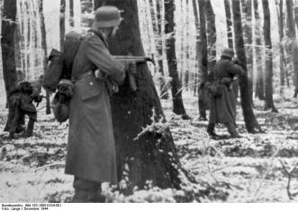 Volksgrenadiers, equipped with StG 44, fighting in the Ardennes.