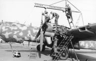 "A He 177 having an engine maintenance overhaul - note the second cylinder's exposed exhaust stub being even with the leading edge, an indication of the rearwards location of the ""power systems""."