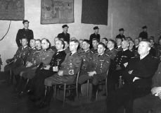 "Representatives of German dignity under the "" State Act in Akershus "" on February 1, 1942, when Quisling's ""national government"" was instituted. Rikskommissar Terboven's assistant Wegener on the left of the first row with Terboven himself to the far right. Quisling , leads in National Collection (NS), mainly on the Norwegian side (right in the picture)."