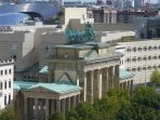 The Brandenburg Gate as seen from the rooftop terrace of the Reichstag building, with the United States Embassy in the background.