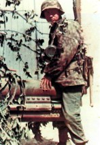"""A grenadier from 12. SS-Panzer-Division """"Hitlerjugend"""" in Normandy (France), Summer 1944. He is wearing italian Telo Mimetico M29 camo trousers that were common throughout the 12th SS in Normandy."""