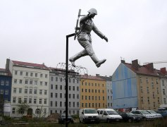 "Sculpture called Mauerspringer (""Wall jumper"") by Florian and Michael Brauer and Edward Anders."