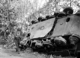 General Eisenhower reviewing damage (including a wrecked Tiger II) in the pocket at Chambois.
