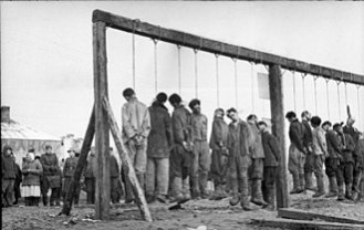 Soviet partisans hanged by German forces in January 1943.