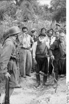 Fallschirmjäger paratroopers at Kondomari, Crete confronting Cretan Greek villagers.