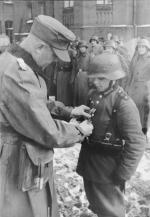 16-year-old Willi Hübner being awarded the Iron Cross in March 1945.