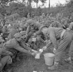 German prisoners taken during the battle are given tea by their captors.