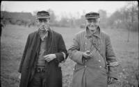 Two old members of the Volkssturm seem relieved to have surrendered to British troops in Bocholt, 28 March 1945.