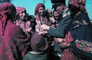 Luftwaffe mann with locals.