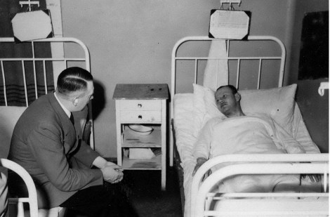 Hitler visiting Heinrich Borgmann in hospital after the failed 20 July bomb, 1944.