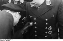 U-boat War Badge seen on the tunic of a sailor being presented with the German Cross in gold.