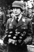 Lieutenant Otto Fries holds Ehle's medal pillow.