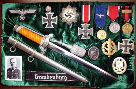 Wilhelm Walther's awards with the cuff title.