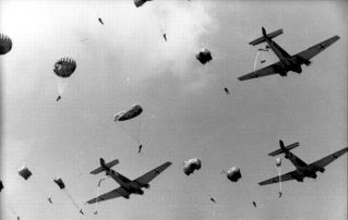 "Kurt Rybka's men taking the jump during the company ""Rösselsprung"": 314 paratroopers jumped into a wasp nest and partly to death. SS-Hauptsturmführer Rybka, commander of the Luftlandeeinsatzes, was heavily wounded on May 25, 1944, the first day of the mission, and had to be flown out."