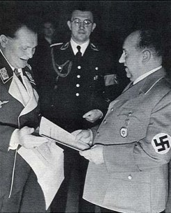 Walther Funk (right) receives his appointment as Minister of Economic Affairs by Hermann Göring.