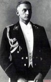 SS Untersturmfuhrer Hugo Gottfried Kraas wearing a SS suit with shoulder straps.