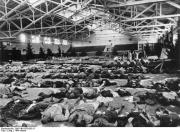 Bombing victims laid out in an exhibition hall, autumn 1944.