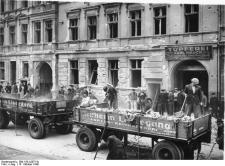 A work party clears rubble from an air-raid on Berlin, 13 October 1940.