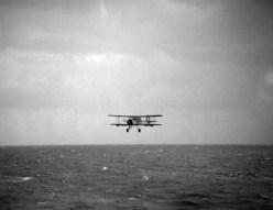 A Swordfish returns to Ark Royal after making the torpedo attack against Bismarck.