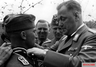Knight's Crossing ceremony for Josef Portsteffen by SA-Obergruppenführer Wilhelm Brückner.