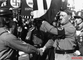 Hitler consecrating with the blood flag.