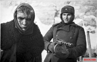 Red Army soldier marches a German soldier into captivity after the victory at Battle of Stalingrad.