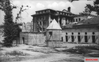 The above-ground portion of the Führerbunker shortly before it was destroyed in 1947. Hitler & Eva Braun's remains were burnt in a shell crater in front of the emergency exit at the left. The circular structure was for generators and ventilation.
