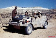 An Afrikakorps' VW KdF Kübelwagen Typ 82 near the Akarit defensive line, the last natural barrier preventing access to the coastal plain of Tunisia from the South. In the passenger seat, Generalmajor Kurt Freiherr von Liebenstein (2nd from left), the commanding officer of 164. Leichte Afrika-Division (note the pennant denoted his command ), speaks with one of his men.