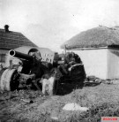 This picture was taken by Kriegsberichter Koster on 16 October 1941 at Uman (Ukraine) and show a Russian Heavy Tractor Stalinez - ChTZ S-60 with an 152-mm howitzer M1938 (M-10) gun in its stowed position, drove into the wall of a village house after its crew was killed by attacking German troops.