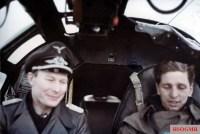 """Bomber ace Major Werner Baumbach (left, Gruppenkommandeur III.Gruppe / Kampfgeschwader 30 """"Adler"""") as a """"Fluggast"""" inside the cockpit of a Heinkel He 111."""