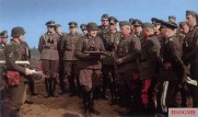This picture was taken in Belgium in May 1940 and showing Generaloberst Walther von Reichenau (3rd from right, front row) listen intently with his staff officers while Oberstleutnant Hans Mikosch explaining the unit operation with his map. Front row, from left to right: Mikosch (Kommandeur Pionier-Bataillon 51), Generalleutnant z.V. Siegfried Haenicke (Kommandeur 61. Infanterie-Division), Reichenau (Oberbefehlshaber 6. Armee), General der Infanterie Viktor von Schwedler (Kommandierender General IV. Armeekorps), and Generalmajor (Luftwaffe) Otto Deßloch (Kommandierender General II. Flakkorps).