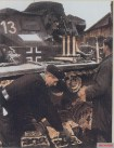 German tank crews from Panzer-Regiment 15 / 11.Panzer-Division loaded 5cm L60 (KwK39) shells in their Panzerkampfwagen III tank.