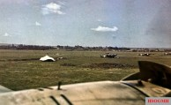 This photo was taken by none other than Generalfeldmarschall Erwin Rommel himself, above a Heinkel He 111 at some Axis airfield in North Africa in 1941. Airplanes in the background are Italian (white cross on rudder), looks like Sparviero or CANT Z1007 bis (twin tail version).