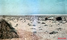 North African desert in the time of Rommel's push to Egypt. There is a Sani vehicle in the background.