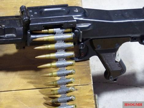MG 34 with inserted Gurt 34 reusable non-disintegrating metal ammunition belt.