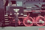 "The newly delivered Reichsbahn train with factory number ""50 467"" in Thorn (East Prussia.) The Reichsbahner (railway worker) at the front of the camera wearing a special uniform for the occupied territories with 8 buttons (usually 6), and the rare and only briefly used Litzenkragenspiegel of Generalgouvernement Polen. Unfortunately, the photographer had no steady hand and it has bit blurred when shooting. Also noteworthy is the Reichsbahn Adler, in which here the two letters ""D"" and ""R"" are attached on both sides of the emblem, which was more typically used in cars. The picture was taken by Walter Hollnagel in June 1940."