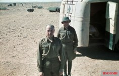 Officer of the German Afrikakorps in front of Italian vehicle. They are wearing tropical uniform with pith helmet (tropenhelm). Photo taken by General Erwin Rommel during his Campaign in North Africa, 1941.