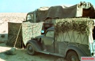 Italian vehicles in the African desert. At the front is Fiat Balilla 1100 Furgoncino, while in the background is FIAT type 666. Photo taken by General Erwin Rommel during his Campaign in North Africa, 1941.
