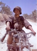 A Grenadier from Hermann Göring Division in Tunisia, 1943. He ride an Italian Bianchi motorcycle (produced in 1936-1940 period). Not enough of the bike is shown to identify the model, but possibly a 500cc model.