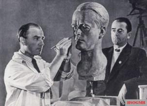 Arno Breker carves a portrait of Albert Speer in 1940.