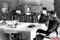 Theo Osterkamp's birthday party on 15 April 1941; from left to right: Major Wenzel (Mölders' aide), Adolf Galland, Mölders and Osterkamp.