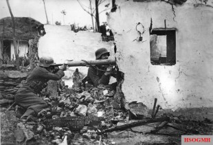 Soldiers of the German Großdeutschland division's Panzerfüsilier regiment prepare an ambush in the ruins of a destroyed building on the Eastern Front, 1944.