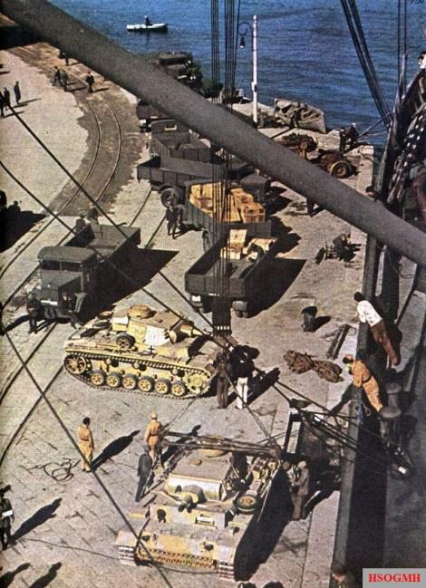 Panzerkampfwagen III ausf N medium tanks are unloaded form a transport at Bizerte, Wilāyat Binzart, Tunisia, 23 November 1942.