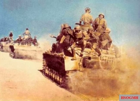 A column of Panzerkampfwagen IVs on the move. Some of the men appear to be wearing the tropical hat (tropenhelm) first issued in 1941.