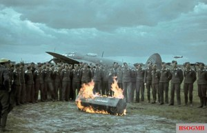 "It is extremely unusual photograph of World War II in color. The German pilots of the bombers Heinkel He-111 and symbolic funeral. At a coffin inscription in German: ""Dein leben – dein gewinn"" – your life – your reward. And ""mich auch"" – for me, too. Picture was taken by Siegfried Lauterwasser at Tatsinskaya airfield (Stalingrad), fall of 1942."